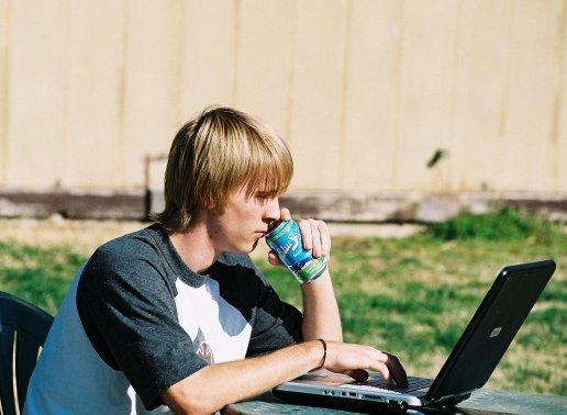 Sitting at laptop